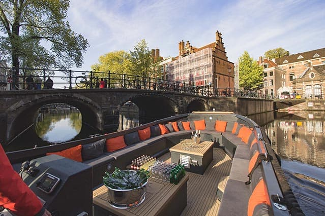 Private boat Nomag in the canal of Amsterdam